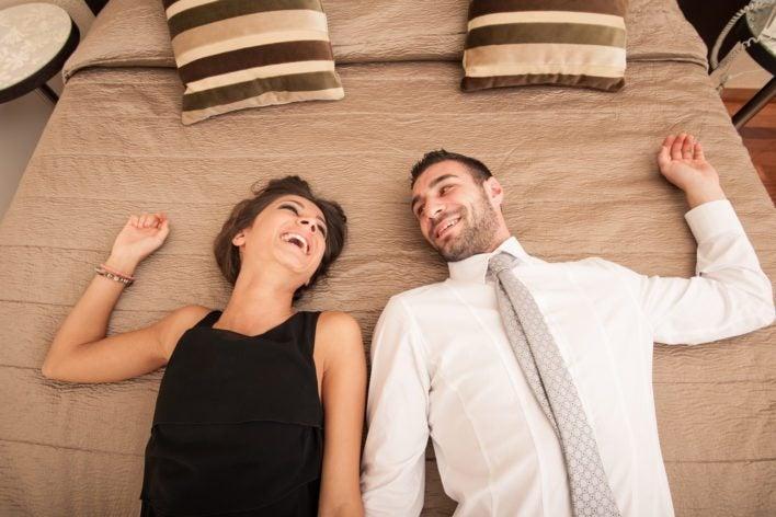 Couple Enjoying Hotel Bed