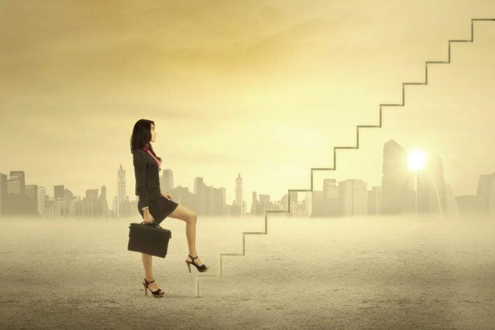 Woman Climbing Ranks