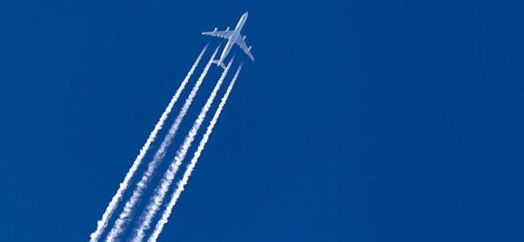Large Plane Soaring Across Sky