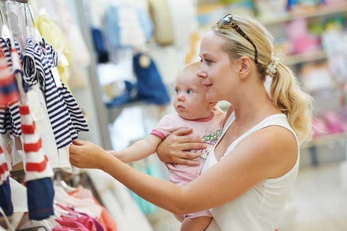 Mom With a Baby Shopping for Clothes