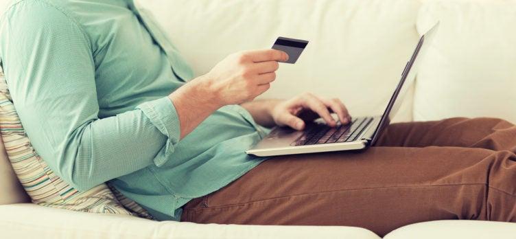 Man Using credit card on computer