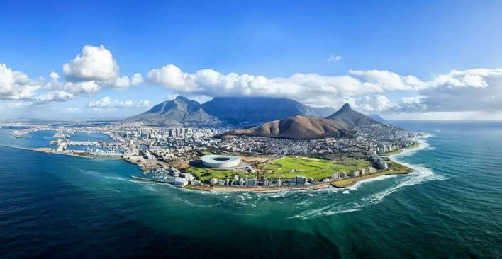 If you want to escape the big cities on your next trip, head to Cape Town, South Africa. Make sure to have a glass of wine for us while you are there! Image courtesy of travelstart.co.za.