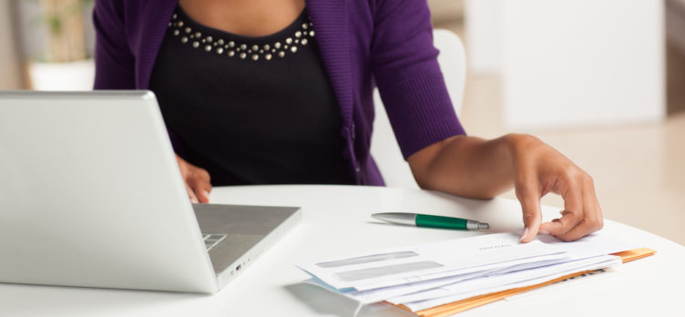 Woman working on finances at home