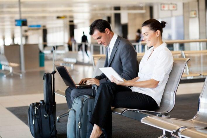 airport laptop couple