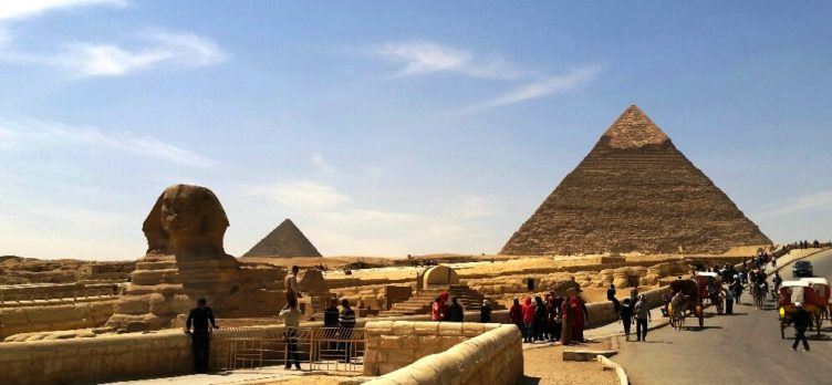 Cairo pyramids with tourists