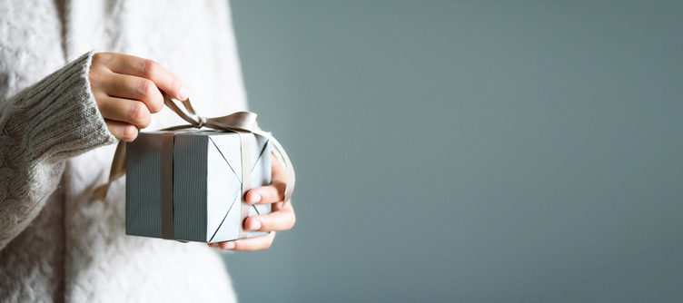 Woman Holding Gift for Best Gifts For Travelers