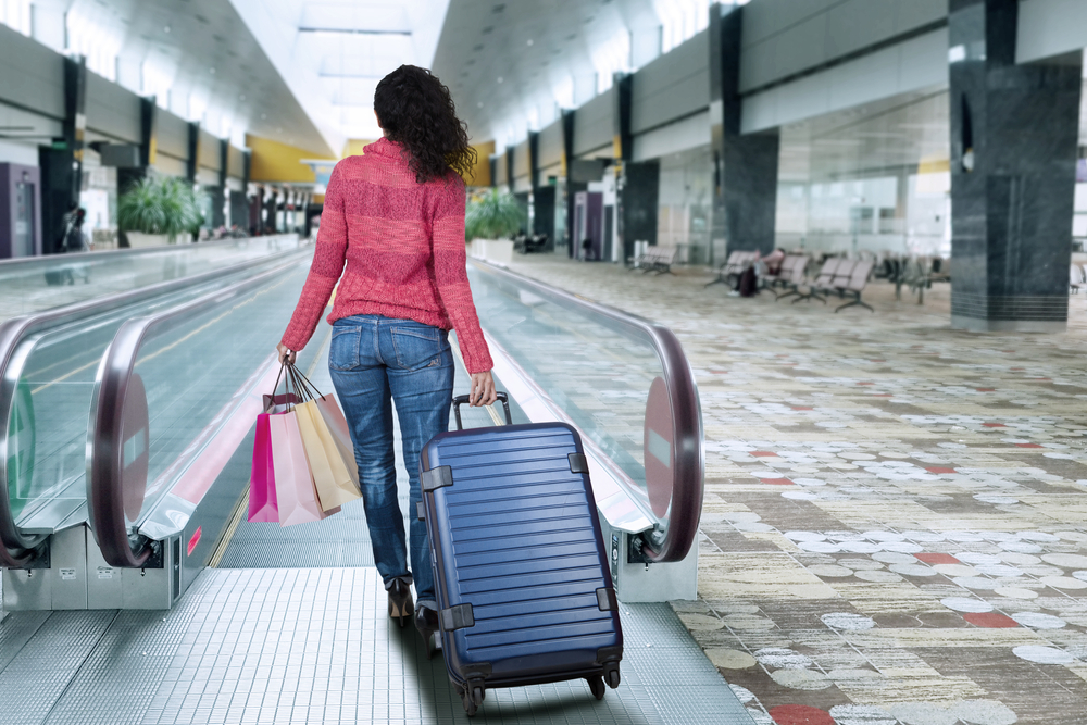 Lady with carry-on luggage