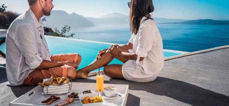 Couple Eating Breakfast Poolside