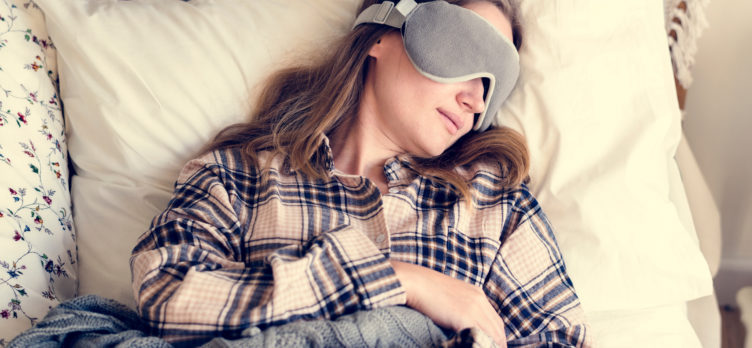 Lady sleeping with a sleep mask