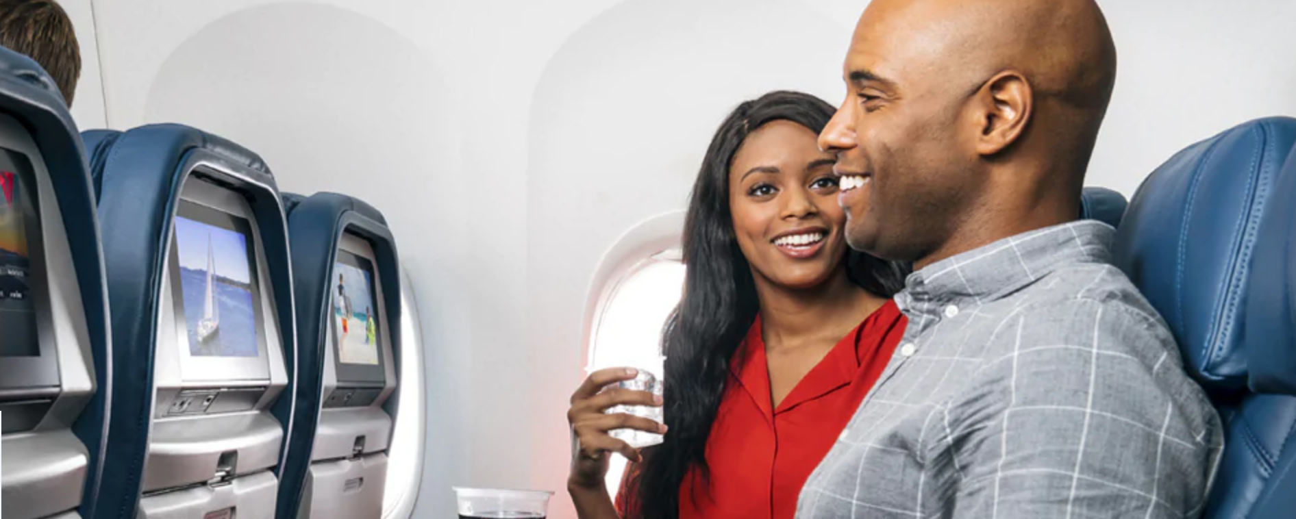 man and woman flying on a Delta airplane