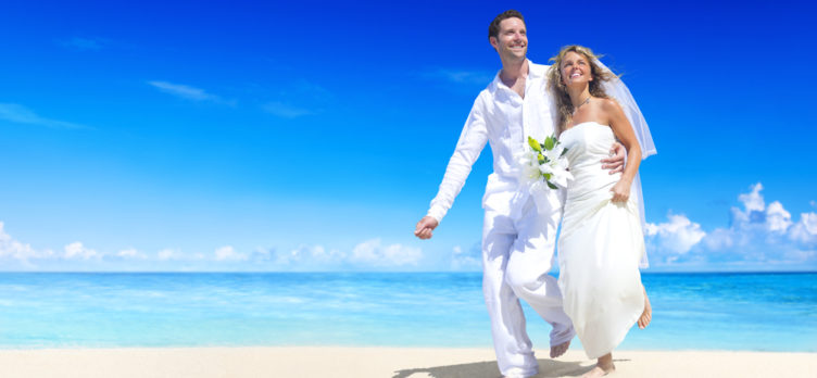 Young married couple on the beach