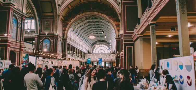 People Walking A Tradeshow Floor