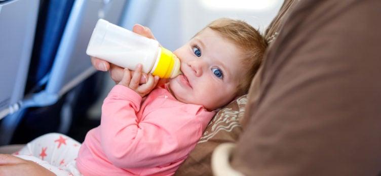 Baby Drinking Milk on a Plane