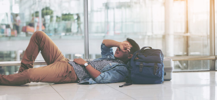 Man Laying on the Floor at An Airport