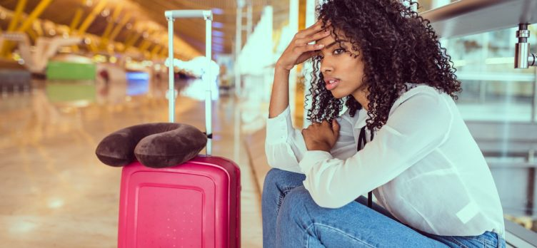Woman Stressed with Luggage