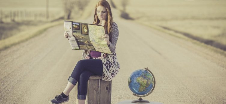 woman suitcase globe map searching highway