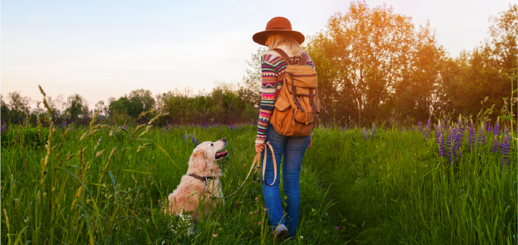 Lady and her dog outside in a field