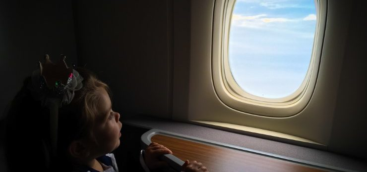 Toddler Looking Out American Airlines 777 Business Class Window