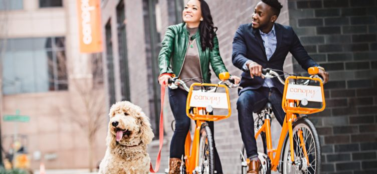 Couple Riding Bikes with Dog at Canopy Pet Friendly Hotels