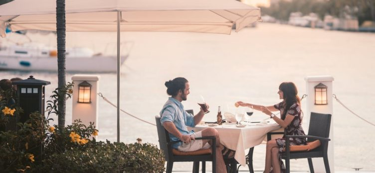 Couple dining out waterfront