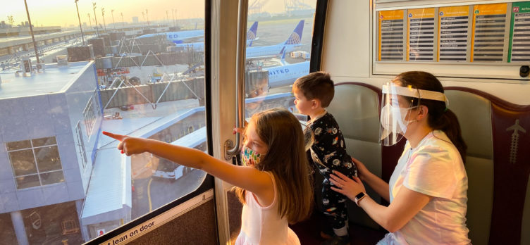 Family riding the terminal train at EWR during sunrise New Jersey