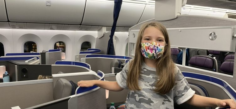 Girl wearing mask in United Polaris Business Class