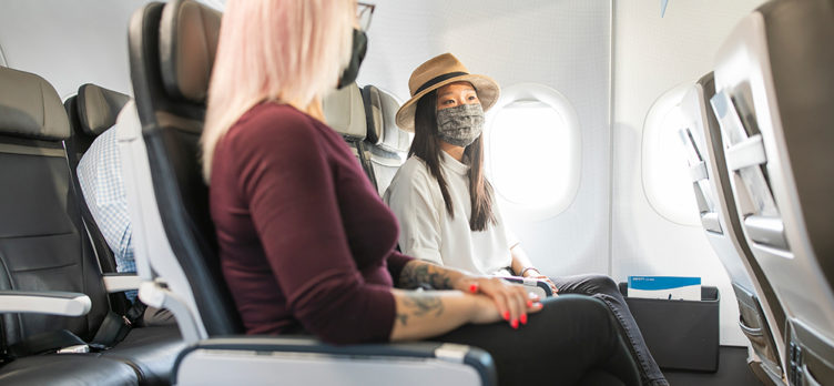 Women Flying Alaska Air with Masks During COVID