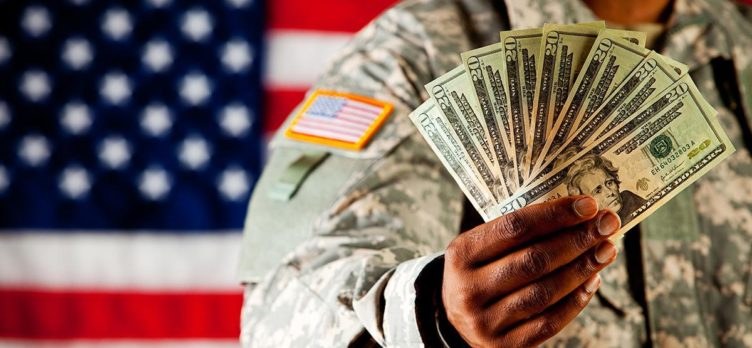 Military solider holding cash