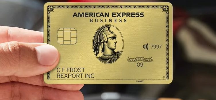 Hand holding Amex Business Gold Card