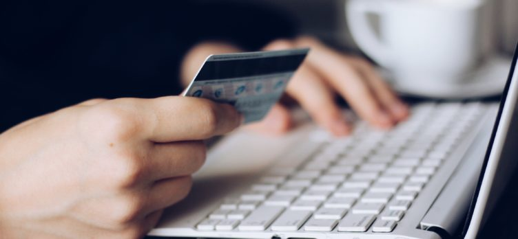 Man shopping with credit card online on a laptop