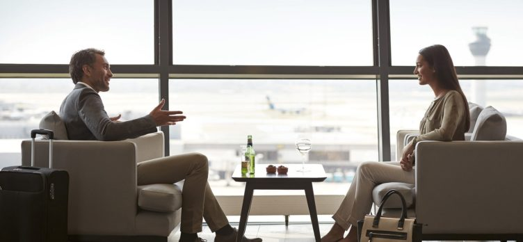 Priority Pass 2 passengers conversing at a lounge