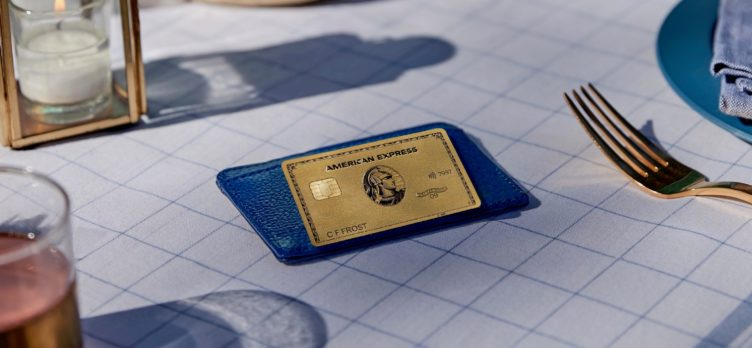 Amex Gold Card on blue wallet at table