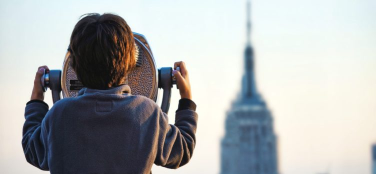 Boy looking at Empire State Building in New York City
