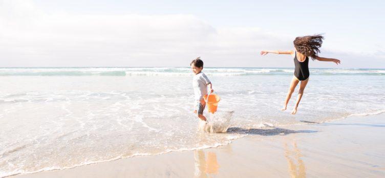 Kids on the beach in San Diego Image Credit Garrett Patz via Unsplash