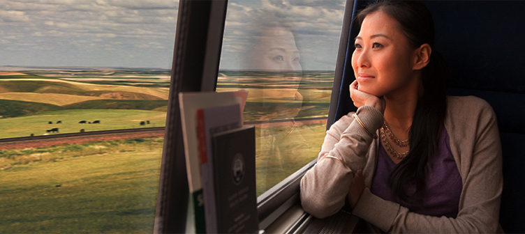 Amtrak traveler looking out of train window