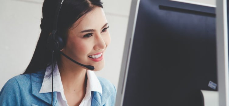 Call center woman smiling on phone
