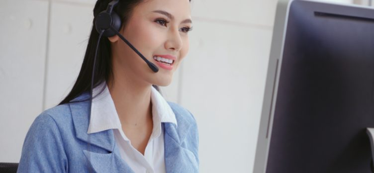 Call center woman with headset smiling