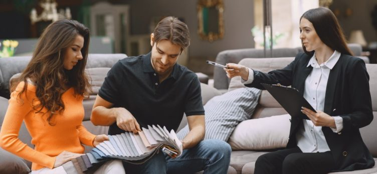 Couple selecting fabric at furniture store 1