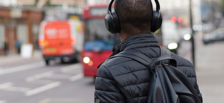 Man with headphones and backpack