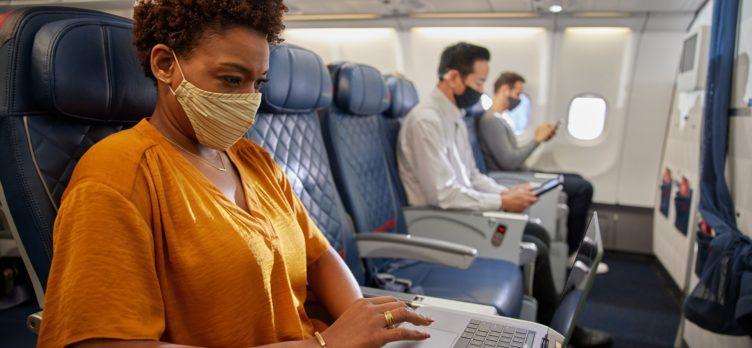 Masked customer on Delta aircraft
