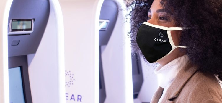 Woman in mask uses CLEAR