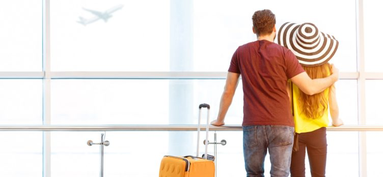 Couple watching planes at airport